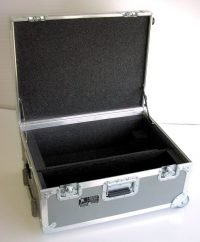 Heavy duty case with custom divided interior and tilt wheels with extension handle.